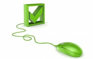 A green computer mouse and tick, suggesting editing