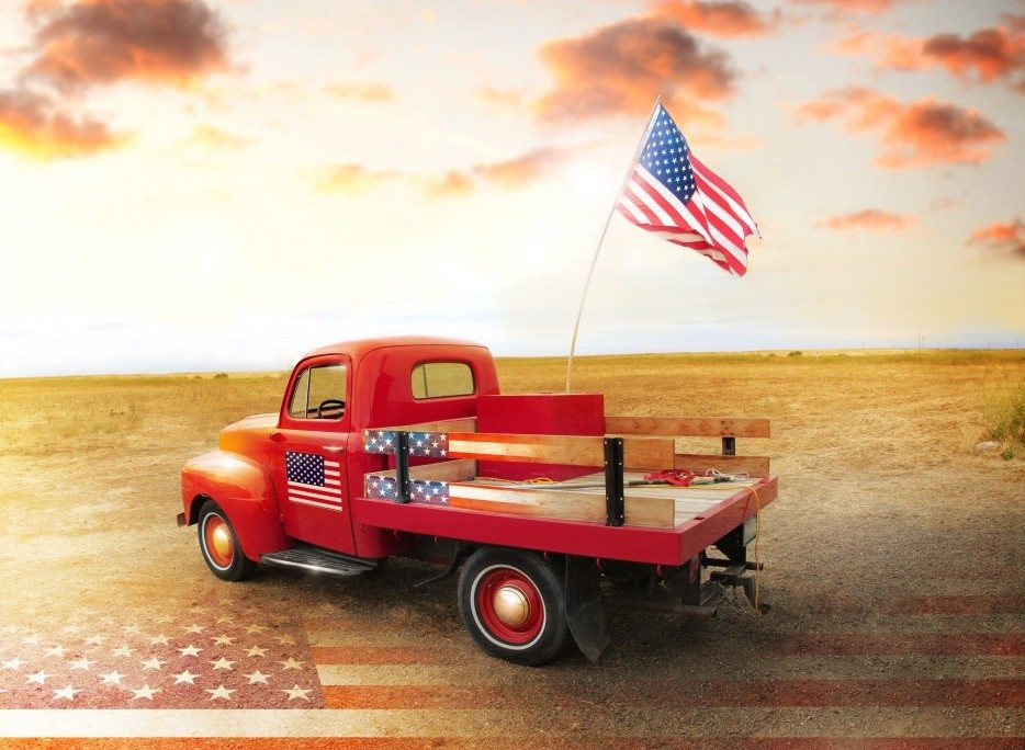 American pick up truck with US flag