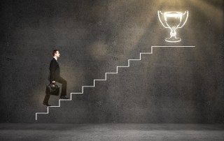 Business leader climbing awards ladder