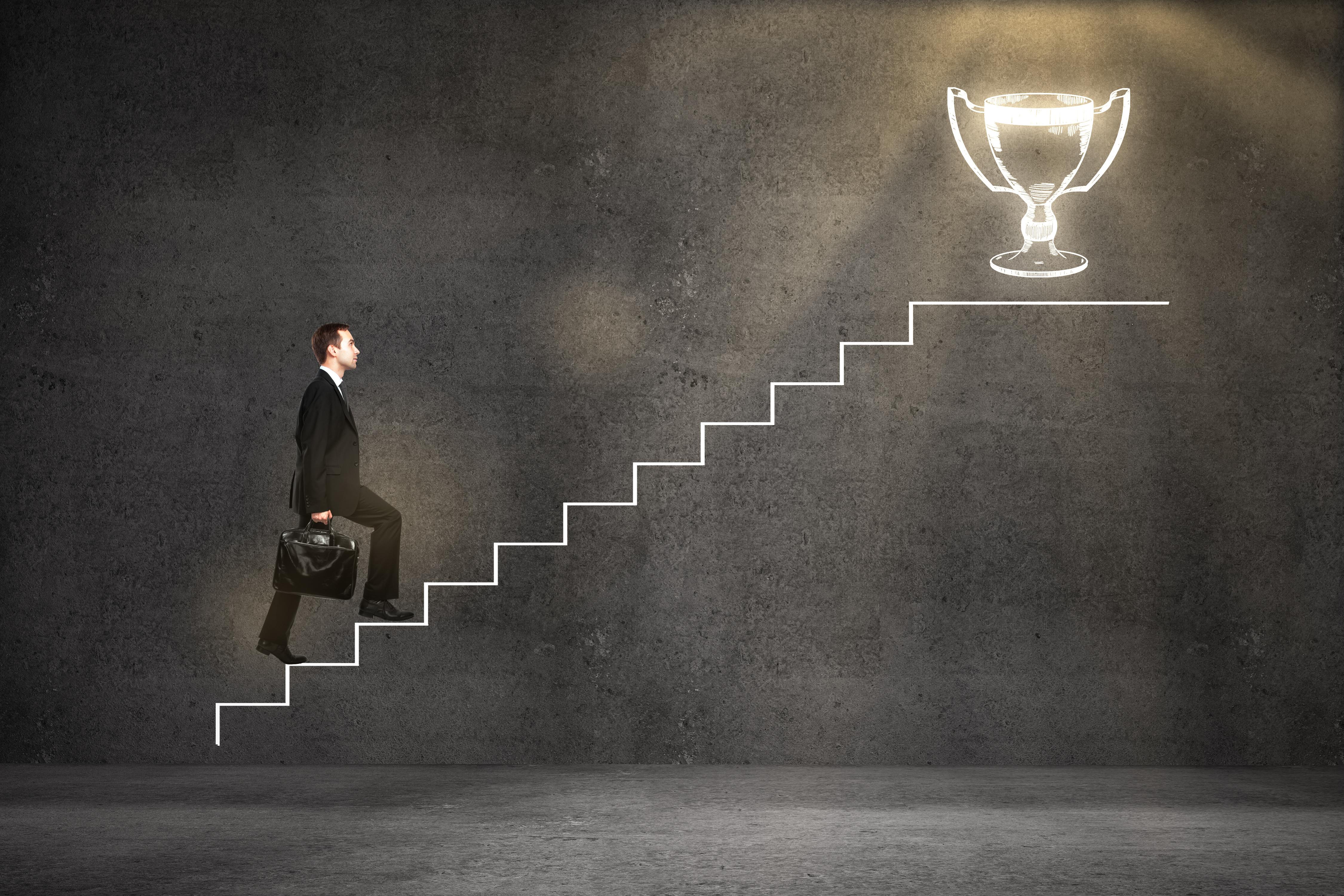 Business leader climbing awards ladder